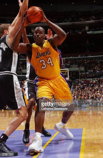 Shaquille O'Neal of the Los Angeles Lakers tries to get to the basket past Rasho Nesterovic of the San Antonio Spurs during the first half at Staples...