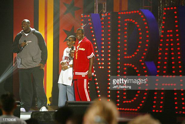 Shaquille O'Neal of the Los Angeles Lakers Usher and NBA Inside Stuff host Ahmad Rashad address the crowd during the Read to Achieve Celebration on...