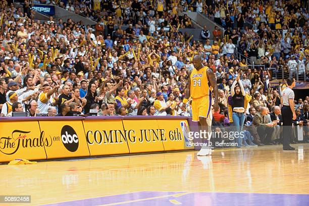 Shaquille O'Neal of the Los Angeles Lakers walks down the sideline in Game Six of the Western Conference Semifinals during the 2004 NBA Playoffs...