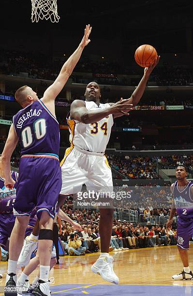 Shaquille O'Neal of the Los Angeles shoots over Greg Ostertag of the Utah Jazz during the game at Staples Center on December 7 2003 in Los Angeles...