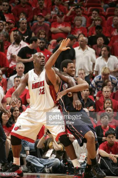 Shaquille O'Neal of the Miami Heat and Jason Collins of the New Jersey Nets battle for position in Game one of the Eastern Conference Quarterfinals...