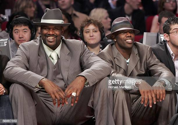 Shaquille O'Neal of the Miami Heat and NFL wide receiver Terrell Owens watch the Footlocker ThreePoint Shootout competition during NBA AllStar...