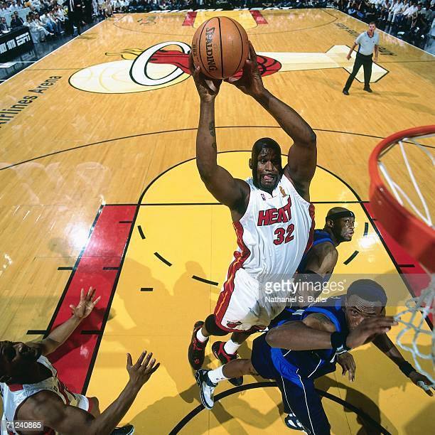 Shaquille O'Neal of the Miami Heat attempts a shot against Erick Dampier of the Dallas Mavericks during Game Four of the 2006 NBA Finals played June...