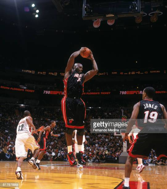 Shaquille O'Neal of the Miami Heat collects a rebound during the game against the Cleveland Cavaliers at American Airlines Arena on November 4 2004...