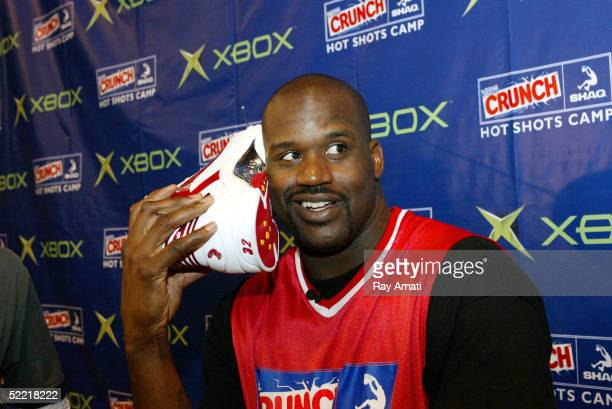 Shaquille O'Neal of the Miami Heat demonstrates his new shoe cell phone after judging the skills of ten young players competing for a spot at Nestle...