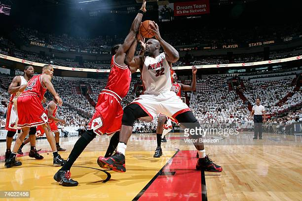 Shaquille O'Neal of the Miami Heat drives against Ben Wallace of the Chicago Bulls in Game Four of the Eastern Conference Quarterfinals during the...