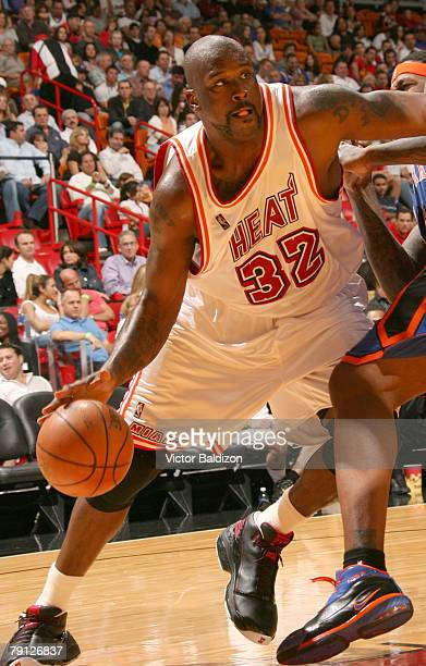 Shaquille O'Neal of the Miami Heat drives against Eddy Curry of the New York Knicks on January 19 2008 at the American Airlines Arena in Miami...