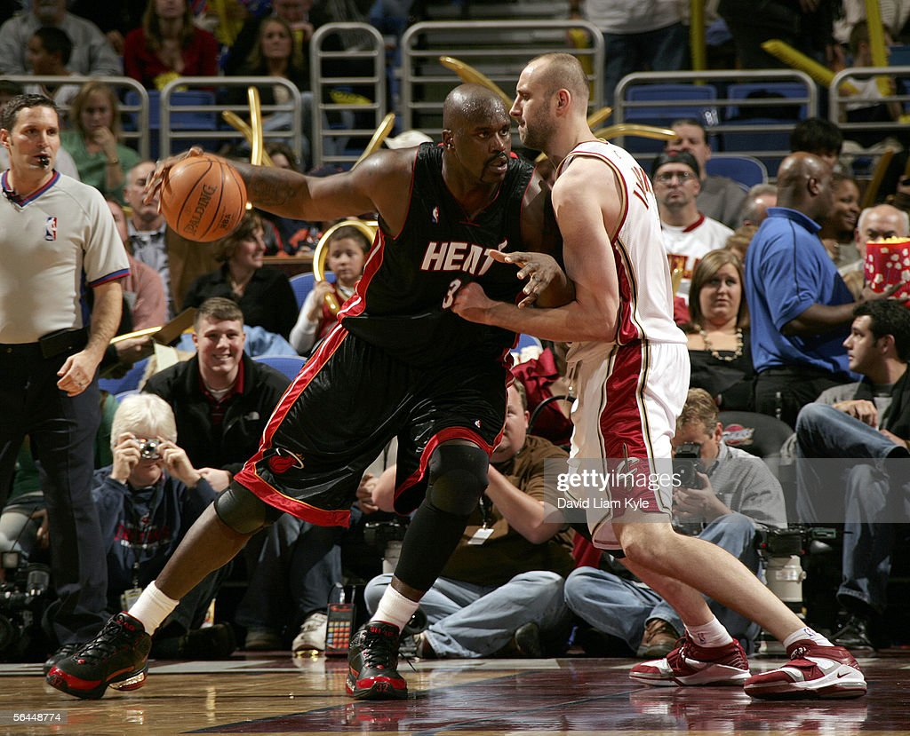 Shaquille O'Neal #32 of the Miami Heat drives into Zydrunas Ilgauskas #11 of the Cleveland Cavaliers December 17, 2005 at The Quicken Loans Arena in Cleveland, Ohio.