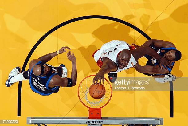 Shaquille O'Neal of the Miami Heat dunks against Adrian Griffin of the Dallas Mavericks during Game Three of the 2006 NBA Finals June 13 2006 at...