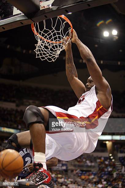 Shaquille O'Neal of the Miami Heat dunks against the Memphis Grizzlies during preseason NBA action at Coliseo de Puerto Rico Jose Mario Agrelot on...