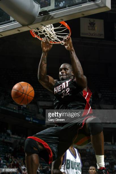 Shaquille O'Neal of the Miami Heat dunks against the Milwaukee Bucks during the NBA game at the Bradley Center on December 8 2004 in Milwaukee...