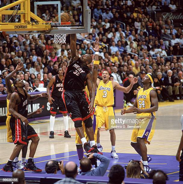Shaquille O'Neal of the Miami Heat dunks during a game against the Los Angeles Lakers at Staples Center on January 16 2006 in Los Angeles California...
