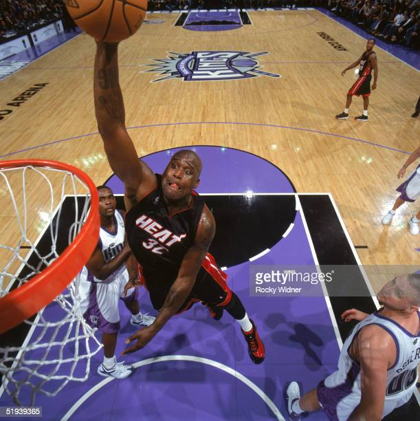 Shaquille O'Neal of the Miami Heat dunks during a game against the Sacramento Kings at Arco Arena on December 23 2004 in Sacramento California The...