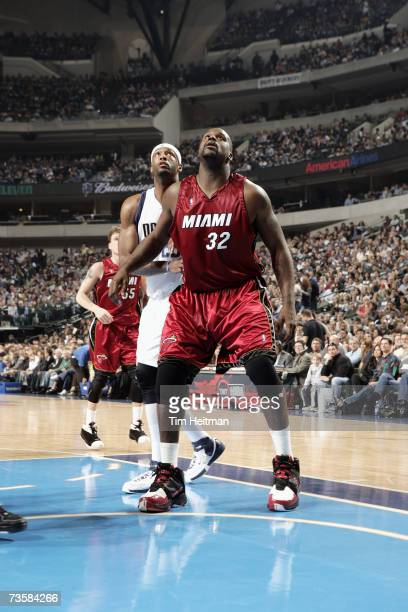 Shaquille O'Neal of the Miami Heat establishes rebound position against Erick Dampier of the Dallas Mavericks during the game on February 22 2007 at...
