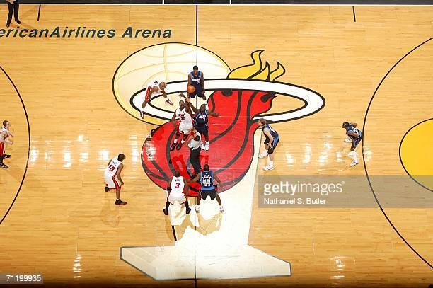 Shaquille O'Neal of the Miami Heat fights for the opeing tip against DeSagana Diop of the Dallas Mavericks during Game Three of the 2006 NBA Finals...