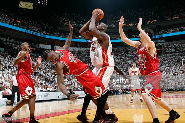 Shaquille O'Neal of the Miami Heat fouls Ben Wallace of the Chicago Bulls in Game Four of the Eastern Conference Quarterfinals during the 2007 NBA...