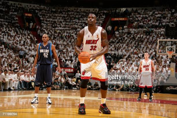 Shaquille O'Neal of the Miami Heat gets set to shoot a free throw attempt against the Dallas Mavericks during Game Three of the 2006 NBA Finals June...