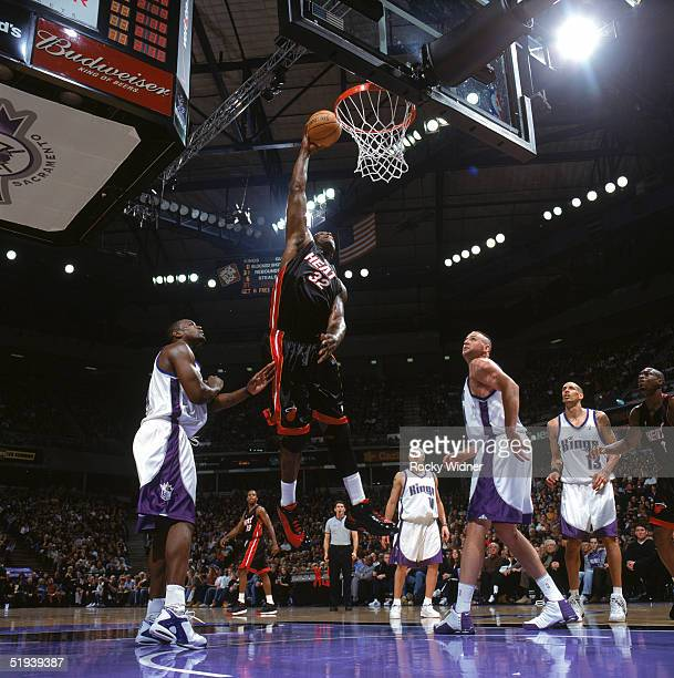 Shaquille O'Neal of the Miami Heat goes for a dunk during a game against the Sacramento Kings at Arco Arena on December 23 2004 in Sacramento...