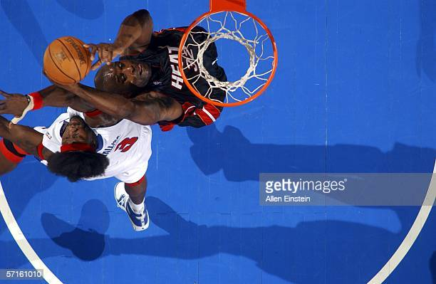 Shaquille O'Neal of the Miami Heat goes up Ben Wallace of the Detroit Pistons in a game on March 22, 2006 at the Palace of Auburn Hills in Auburn...