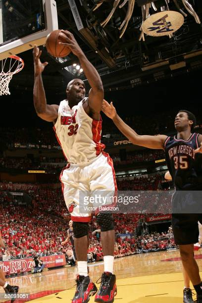 Shaquille O'Neal of the Miami Heat grabs a rebound against the New Jersey Nets in Game one of the Eastern Conference Quarterfinals during the 2005...