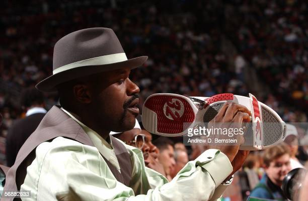 Shaquille O'Neal of the Miami Heat inspects his sneaker video camera during the Sprite Rising Stars Slam Dunk Contest on AllStar Saturday Night...