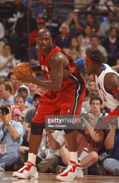 Shaquille O'Neal of the Miami Heat is defended by Ben Wallace of the Detroit Pistons in Game three of the Eastern Conference Finals during the 2005...