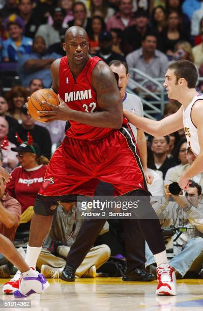 Shaquille O'Neal of the Miami Heat is defended by Chris Mihm of the Los Angeles Lakers during the game on December 25 2004 at the Staples Center in...