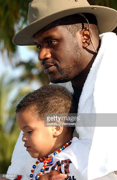 Shaquille O'Neal of the Miami Heat looks on with his son Shaqir during the eighth Annual Miami Heat Family Festival on March 20 2005 at the...