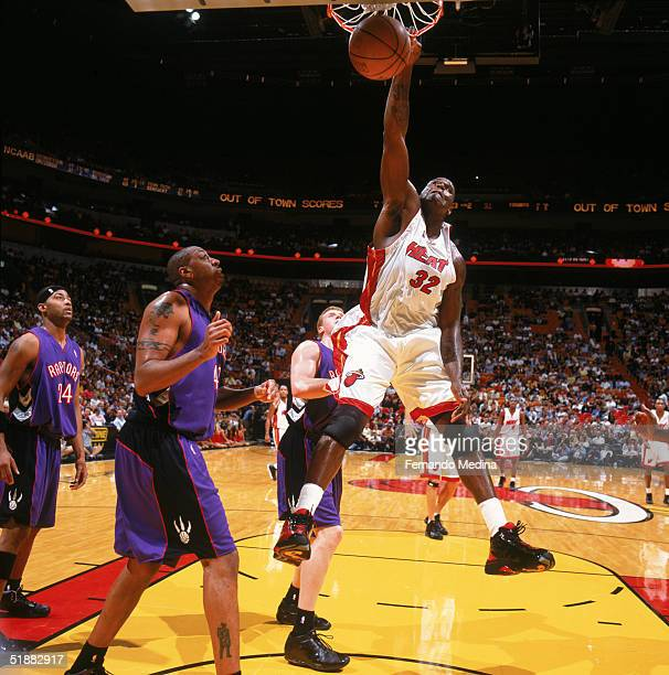 Shaquille O'Neal of the Miami Heat makes a dunk against Donyell Marshall of the Toronto Raptors at American Airlines Arena on November 30 2004 in...