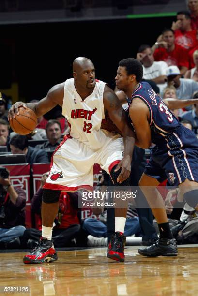 Shaquille O'Neal of the Miami Heat moves the ball against Jason Collins of the New Jersey Nets in Game one of the Eastern Conference Quarterfinals...