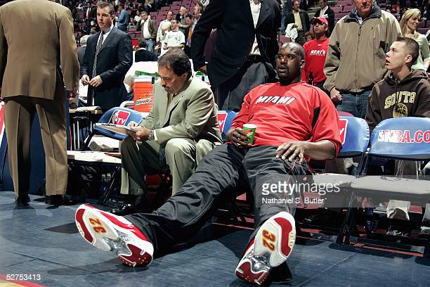 Shaquille O'Neal of the Miami Heat rests as head coach Stan Van Gundy prepares before Game three of the Eastern Conference Quarterfinals with the New...