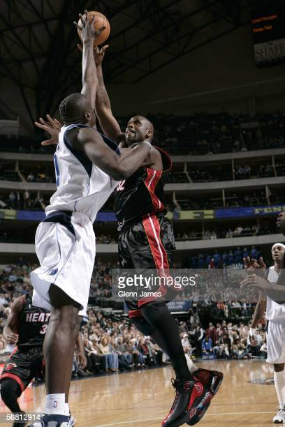 Shaquille O'Neal of the Miami Heat shoots a hook shot over DeSagana Diop of the Dallas Mavericks on February 9 2006 at American Airlines Center in...