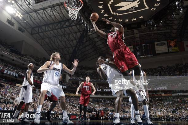 Shaquille O'Neal of the Miami Heat shoots against Dirk Nowitzki of the Dallas Mavericks during Game One of the 2006 NBA Finals on June 8 2006 at...