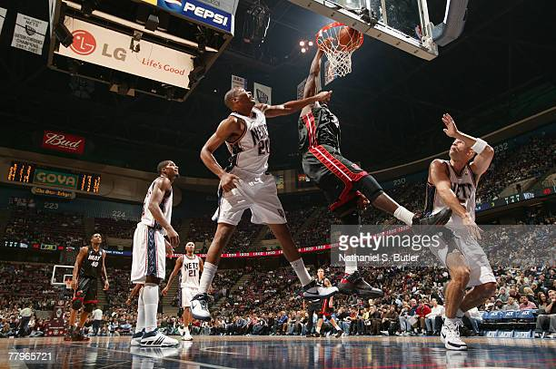 Shaquille O'Neal of the Miami Heat shoots against Jamaal Magloire of the New Jersey Nets on November 17 2007 at the IZOD Center in East Rutherford...