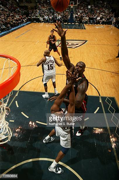 Shaquille O'Neal of the Miami Heat shoots over Jason Collins of the New Jersey Nets on November 10 2006 at the Continental Airlines Arena in East...