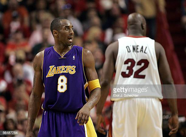 Shaquille O'Neal of the Miami Heat shows his back to Kobe Bryant of the Los Angeles Lakers on December 25 2005 at the American Airlines Arena in...