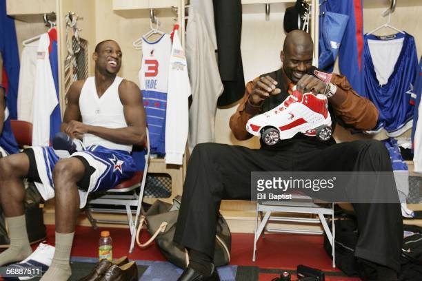 Shaquille O'Neal of the Miami Heat shows off his remote controlled shoe to teammate Dwyane Wade prior to the 2006 NBA All Star Game February 19 2006...