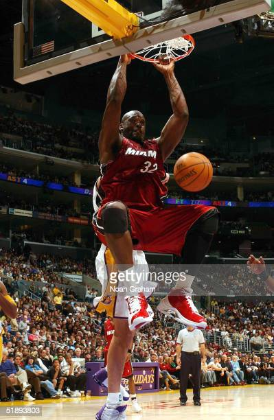 Shaquille O'Neal of the Miami Heat slam dunks against the Los Angeles Lakers on December 25 2004 at the Staples Center in Los Angeles California NOTE...