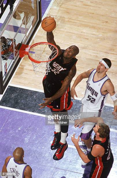 Shaquille O'Neal of the Miami Heat takes the ball to the basket during a game against the Sacramento Kings at Arco Arena on December 23 2004 in...
