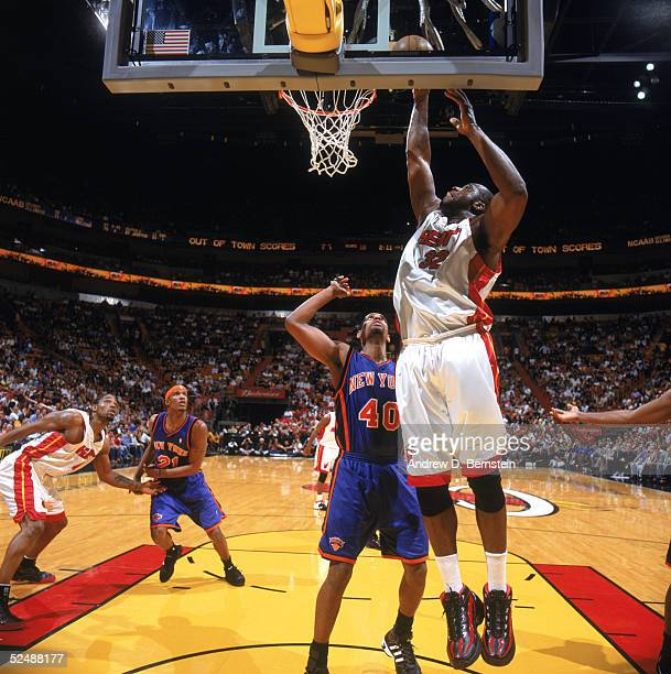 Shaquille O'Neal of the Miami Heat takes the ball to the basket past Kurt Thomas of the New York Knicks during a game at American Airlines Arena on...