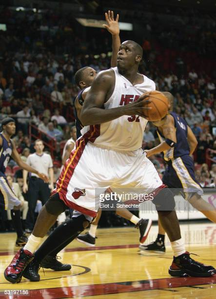 Shaquille O'Neal of the Miami Heat tangles with Lorenzen Wright of the Memphis Grizzlies on December 10 2004 at the American Airlines Arena in Miami...