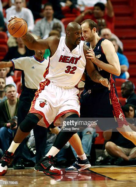 Shaquille O'Neal of the Miami Heat tries to get past Zydrunas Ilgauskas of the Cleveland Cavaliers at American Airlines Arena February 1, 2007 in...