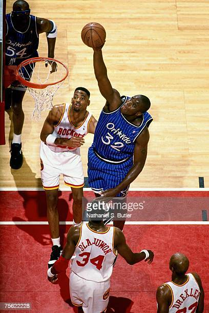Shaquille O'Neal of the Orlando Magic attempts a shot against Hakeem Olajuwon of the Houston Rockets in Game Four of the 1995 NBA Finals played June...