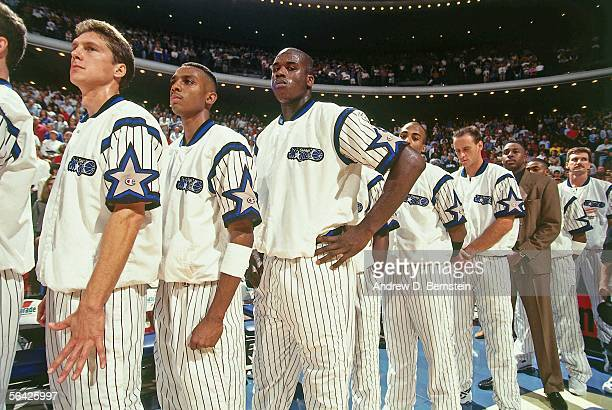 Shaquille O'Neal of the Orlando Magic fourth from left stands with teammates for the national Anthem prior to playing an NBA game at the TD...