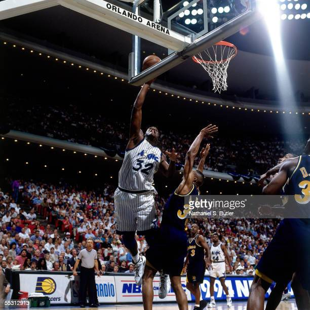 Shaquille O'Neal of the Orlando Magic goes up for shot in Game two in the first Round of the 1994 NBA Eastern Conference Playoffs against the Indiana...