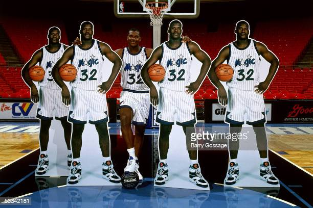 Shaquille O'Neal of the Orlando Magic poses with his life size cutouts on the court at the TD Waterhouse Centre circa 1993 in Orlando Florida NOTE TO...