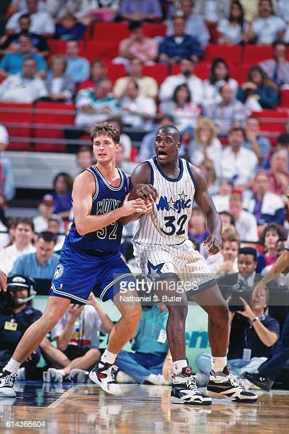 Shaquille O'Neal of the Orlando Magic posts up against Christian Laettner of the Minnesota Timberwolves during a game played circa 1993 at the...
