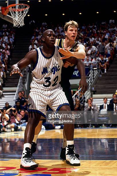Shaquille O'Neal of the Orlando Magic posts up against Rik Smits of the Indiana Pacers during game 5 of the Eastern Conference Finals on May 31 1995...