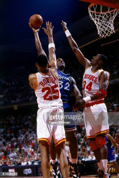 Shaquille O'Neal of the Orlando Magic shoots a hook over Robert Horry and Hakeem Olajuwon of the Houston Rockets in Game Four of the 1995 NBA Finals...