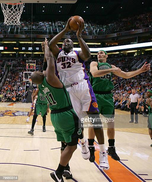 Shaquille O'Neal of the Phoenix Suns drives to the basket against Glen Davis and Scot Pollard of the Boston Celtics at US Airways Center on February...